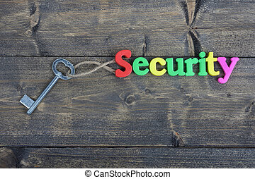 Security on wooden table - Security word on wooden table