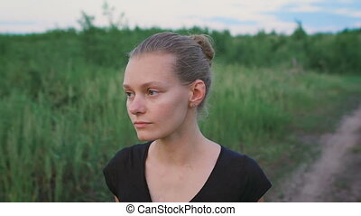 Face of an inspired woman at a field - Woman relaxing in...
