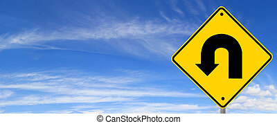 U Turn Sign - U turn road sign, against panoramic blue sky....