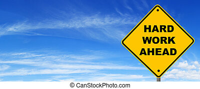 "Hard Work Ahead Road Sign - Road sign warning of ""hard work..."