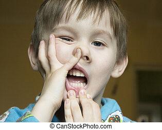 Boy make grimace on his face. Boy ape and make strange face....