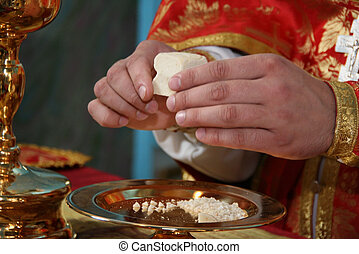 Christian sacrament - Hands of priest consecrates bread...