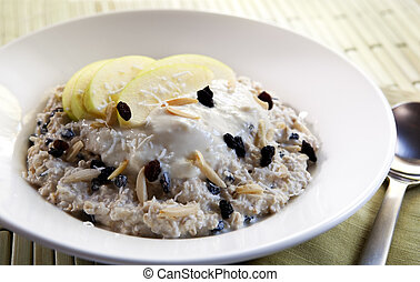 Muesli - Bowl of muesli with yoghurt. Bircher muesli made...