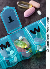 Daily Medication - Daily pill box with medications and...