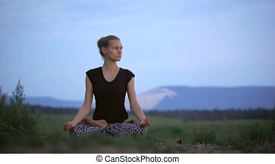 A beautiful young lady sitting in a lotus pose - A beautiful...