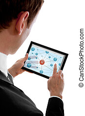 Businessman holding a touchpad pc and surfing in the social...