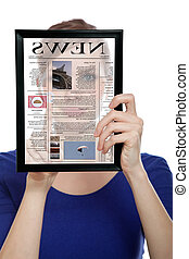 Woman holding a touchpad pc, reading a newspaper - Beautiful...
