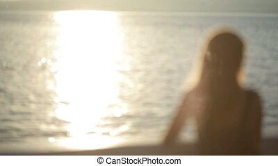 sexy girl in a long dress walks along the beach Embankment -...