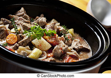 Beef Stew in a slow-cooker, ready to serve