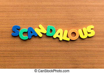 scandalous colorful word on the wooden background