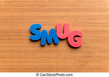 smug colorful word on the wooden background