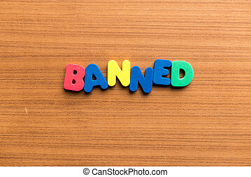 banned colorful word on the wooden background