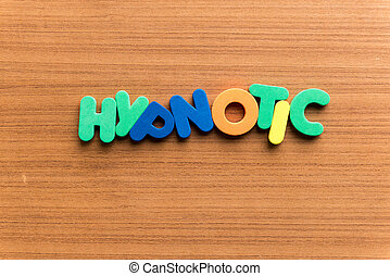 hypnotic colorful word on the wooden background