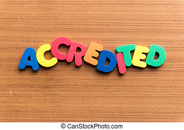 accredited colorful word on the wooden background