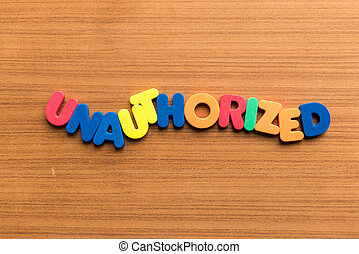 unauthorized colorful word on the wooden background