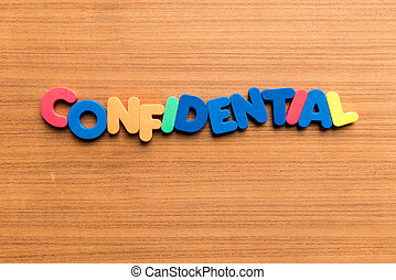 confidential colorful word on the wooden background