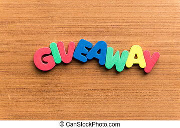 giveaway colorful word on the wooden background