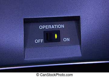Black toggle switch on blue surface - on off