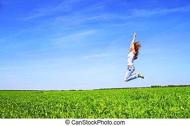 Girl flies over the field