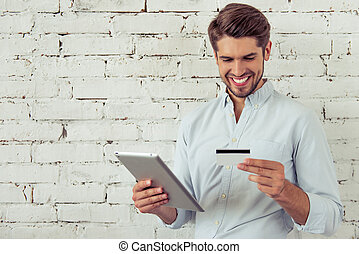 Handsome young businessman with gadget - Handsome young...