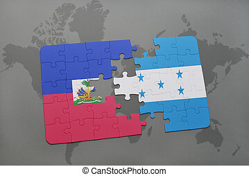 puzzle with the national flag of haiti and honduras on a...