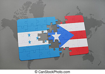 puzzle with the national flag of honduras and puerto rico on...