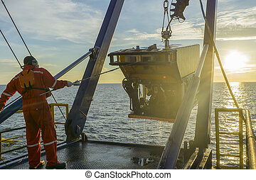 Oil and gas industry - worker recovering robotics Remote...