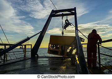 Oil and gas industry - Silhouette of worker recovering...