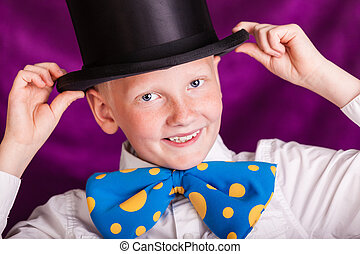 Adorable little boy in a top hat wearing a huge blue and...