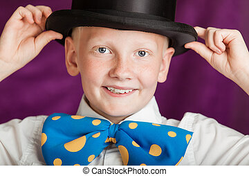 Jaunty young boy in a bow-tie and top hat - Jaunty young boy...