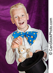 Fun young magician pulling a bunny from a top hat - Fun...