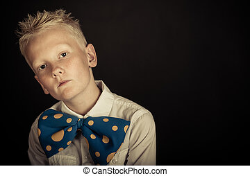 Cute boy in big blue bowtie with copy space - Serious little...