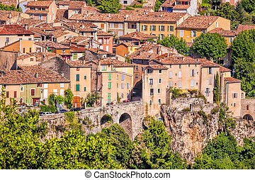 Moustiers Sainte Marie village with rocks in Provence,...
