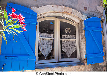 Window with flowers in old house, Provence, France