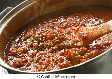 Cooking Bolognese Sauce - Rich Bolognese sauce cooking in a...