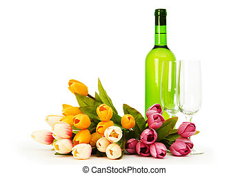Wine and flowers isolated on the white background