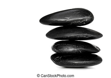 Balanced Stones - Balanced black river stones, isolated on...