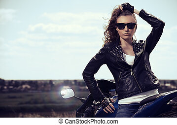 speed concept - Sexual biker woman wearing black leather...