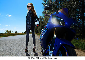 spirit of freedom - Beautiful woman biker alluring by her...