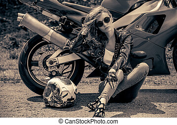 beautiful biker woman - Black-and-white portrait of a...