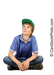 looking up boy - Portrait of a positive teenage boy sitting...