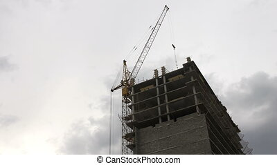 Crane building house. Timelapse