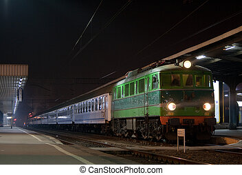 Passenger train waiting at the station platform during the...