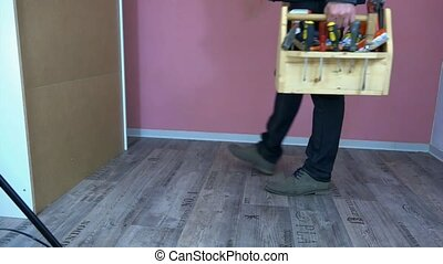 Man with a box of tools came to make repairs