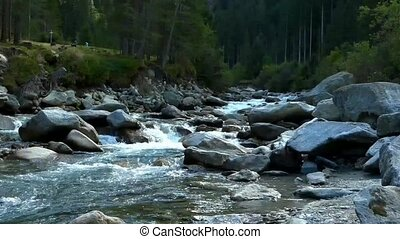 River running from the Alps. Austria. Krimml