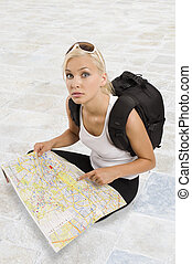 young blond tourist sitting - young pretty student girl in...