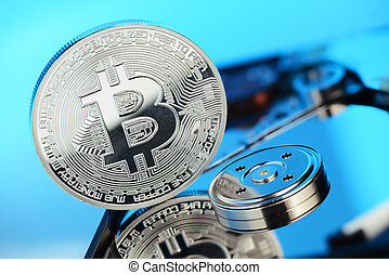 Bitcoin on the HDD disk - Silver Bitcoin coin on the opened...