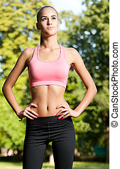 Working out in the park - Beautiful slim healthy young...