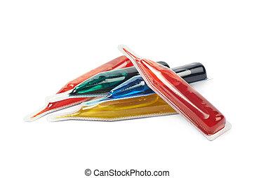 Food dye coloring in a capsule - Pile of a food dye liquid...