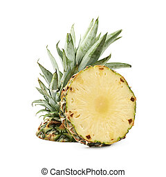 Upper half of a pineapple fruit next to a cross-section...